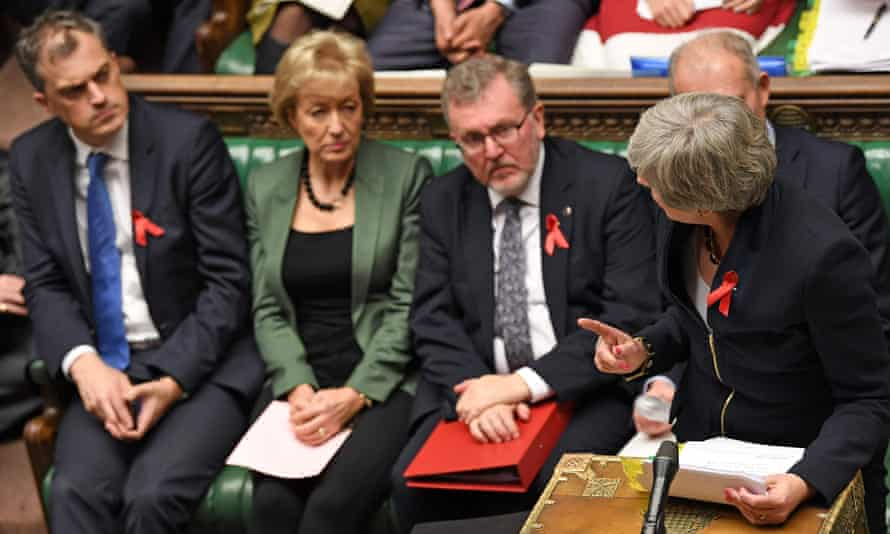 Smith (far left), listens as Theresa May speaks during PMQs.