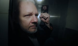 Assange is taken from court in London earlier this month.