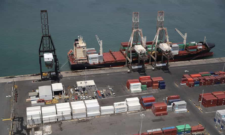 A container ship is seen docked at the port of San Juan as people deal with the aftermath of Hurricane Maria in Puerto Rico this week.