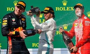 Lewis Hamilton with Max Verstappen (left)  and Sebastian Vettel