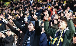 Oxford fans cheer on their side against Swansea.