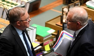 Anthony Albanese and Scott Morrison cross paths during question time in the House of Representatives