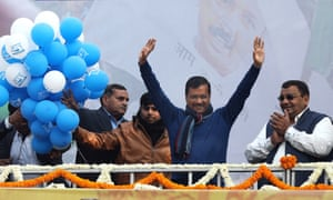 The Aam Aadmi party leader, Arvind Kejriwal, waves at supporters.