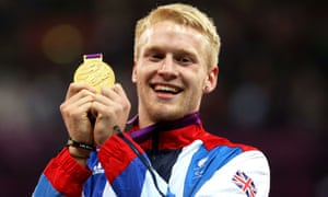 Jonnie Peacock shows off his gold medal at London 2012 when he won the men's 100m T44 race at the Olympic Stadium.