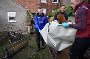 Carlisle United football players help residents clear their properties