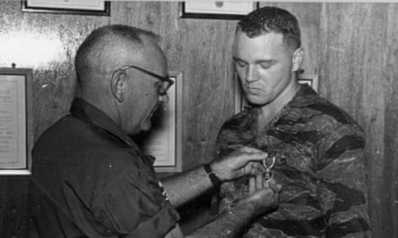 Hollywood derring-do … Bo Gritz gets awarded a purple heart in Erase and Forget.
