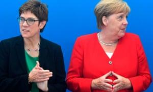 Annegret Kramp-Karrenbauer, left, and Angela Merkel, Germany's chancellor
