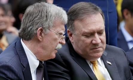 John Bolton and Mike Pompeo confer in the rose garden at the White House in June.