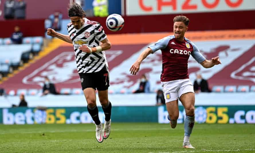 Edinson Cavani beats Matty Cash to the ball before heading past Emiliano Martínez to score Manchester United's third goal.