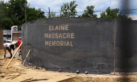 Men work near a monument under construction honoring the victims of the Elaine Massacre in Helena, Arkansas, on 15 June. The memorial is set to be unveiled next month.