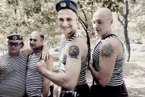 Two young soldiers showing their muscles and tattoos during the paratroopers' day, an elite troop of the Russian army of which many Donbass are a part. While young and old drink vodka, sing and have fun, the fighting continues to rage a few kilometers away, Donetsk