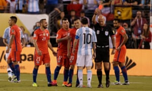 Referee Heber Lopes hands out a red card to Chile midfielder Marcelo Diaz