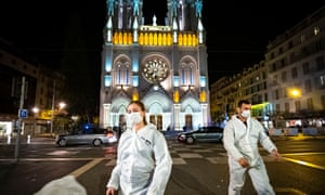 Forensic officers at Notre Dame basilica in Nice on Thursday night.