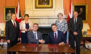 Theresa May stands with first secretary of state Damian Green, while DUP leader Arlene Foster stands with DUP deputy leader Nigel Dodds, as DUP MP Jeffrey Donaldson (in glasses) shakes hands with parliamentary secretary to the Treasury Gavin Williamson inside 10 Downing Street on Monday