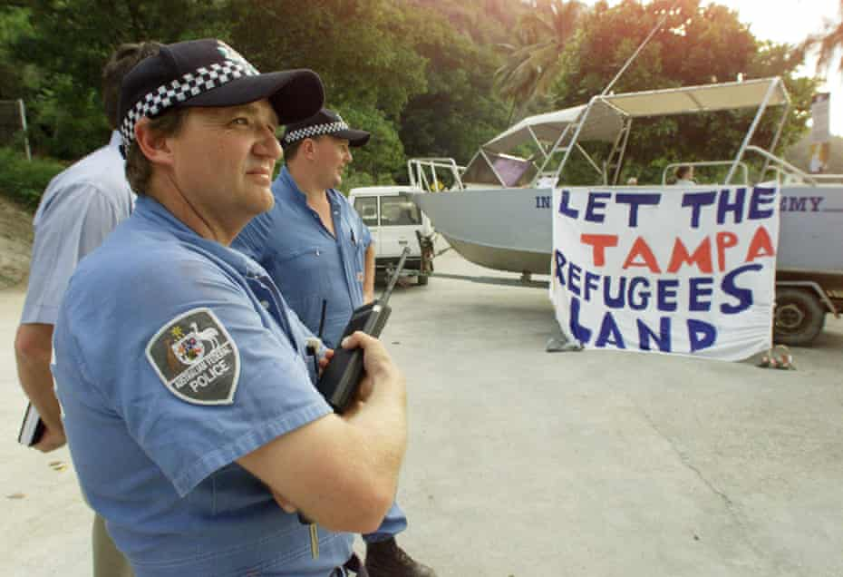 Australian police stand by as residents of Christmas Island protest against the closure of the island's only port on 31 August 2001.