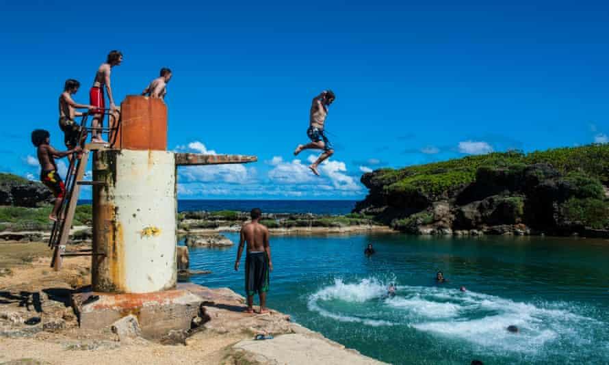 boys swim in guam