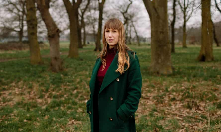 Rachel Williams, writer, with trees behind her