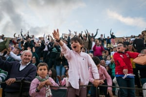 Young spectators in arena in Osuna.