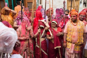 Women are smeared with coloured powder in a spirit of celebration