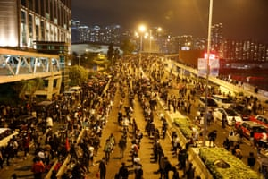 Anti-government demonstrators block a road near the university