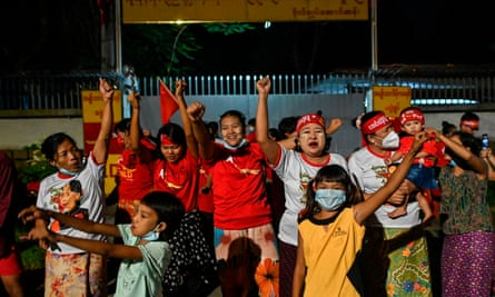 Supporters of the National League for Democracy (NLD) party celebrate in front of the Aung San Suu Kyi's house in Yangon