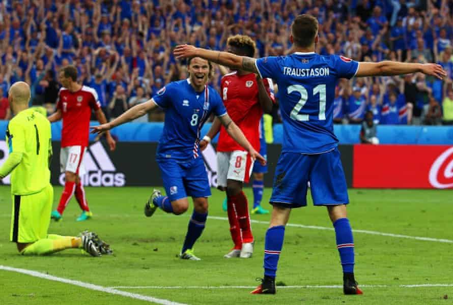 Arnor Ingvi Traustason and Birkir Bjarnason celebrate after the winning goal against Austria.