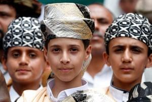 Yemeni children clad in traditional Yemeni attire attend a rally against the Saudi-Hajj pilgrimage ban, in Sanaa, Yemen.