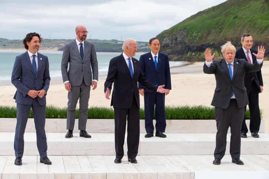Boris Johnson and Joe Biden gesture during the family photo.