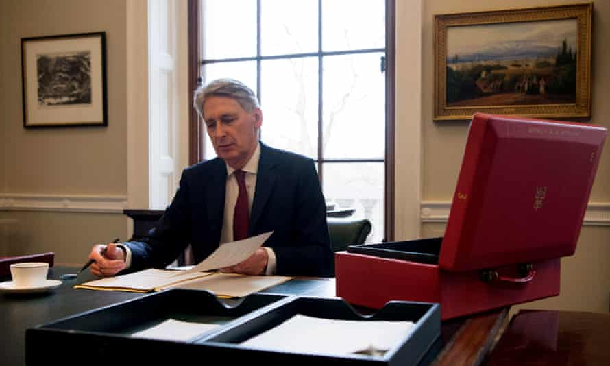 Philip Hammond prepares his speech in his office at the Treasury ahead of his 2017 budget announcement.
