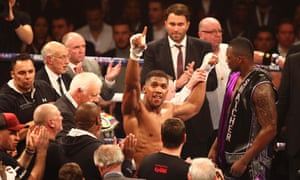 Anthony Joshua celebrates after stopping Dillian Whyte to become British heavyweight champion and continue the unbeaten start to his career.