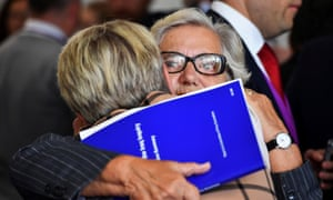 Relatives and friends of military personnel killed during the Iraq war attend after listening to Sir John Chilcot present his report