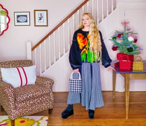 Colour vision: Hannah Weiland with a tree decorated with her own faux-fur baubles. The leopard print upholstery is in homage to her grandmother.