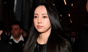 Yunxiang Gao's wife Xuan Dong leaves the NSW supreme court after her husband's bail hearing.