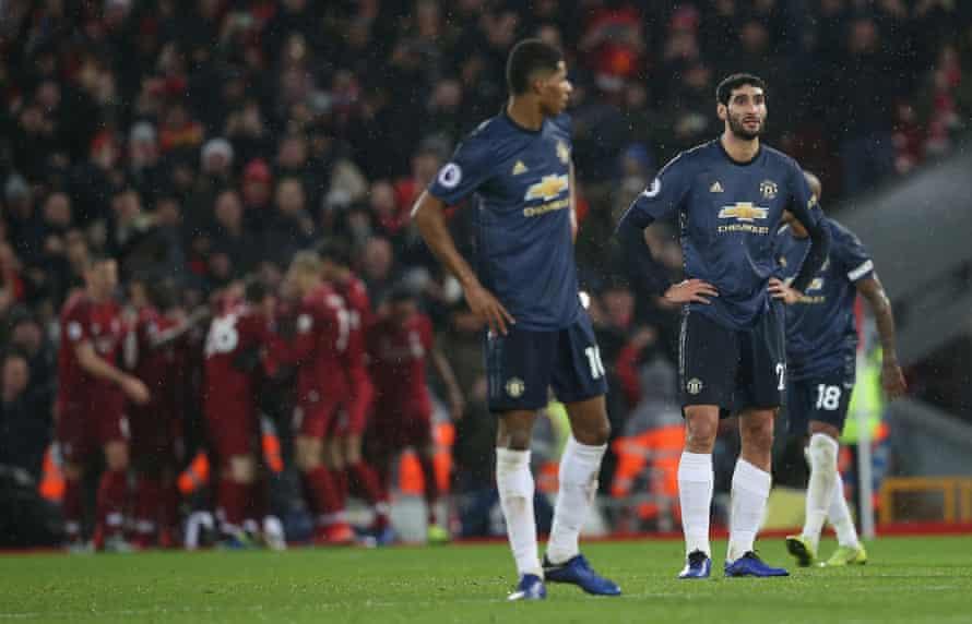 Marouane Fellaini and Marcus Rashford look downcast as Xherdan Shaqiri and his Liverpool teammates celebrate