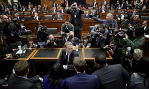 Mark Zuckerberg confers with members of his team on Capitol Hill Wednesday in Washington DC.