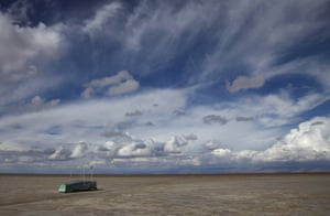 An abandoned boat lies on the dried-up lake bed of Lake Poopo, on the outskirts of Untavi, Bolivia, in January 2016. Drought caused by the recurrent El Niño meteorological phenomenon is considered the main driver of the lake's demise.