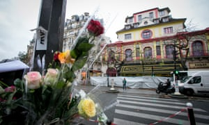 Flowers left near the Bataclan concert hall after November's deadly attacks in Paris.
