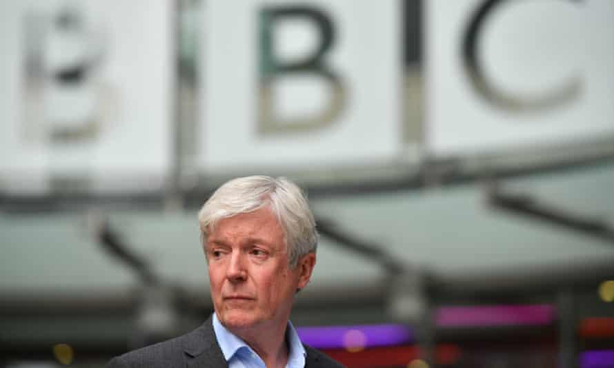 Tony Hall beneath a BBC sign