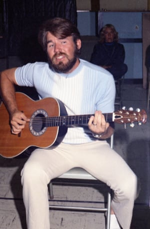 Kenny Rogers playing the guitar in a studio when he was a member of the band The First Edition recording on 7 July 1968 in Los Angeles