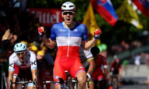 Arnaud Demare celebrates as he crosses the finish line to win stage four of Le Tour de France.