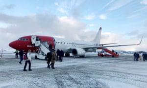 Passengers board a Norwegian Air plane in Norway last winter