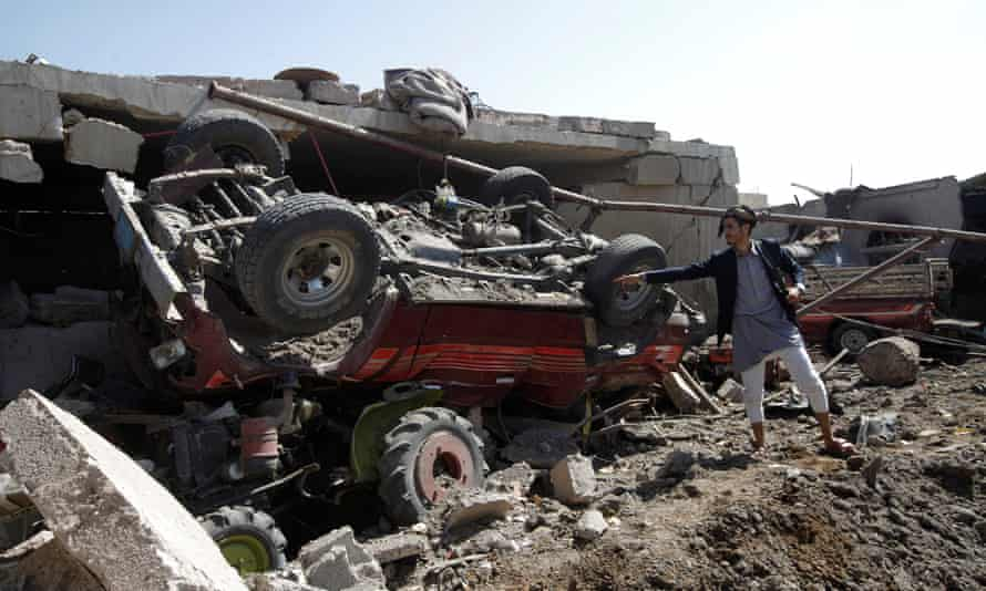 A man shows damage at a house believed to have been destroyed by a Saudi-led airstrike in the Yemeni capital, Sana'a