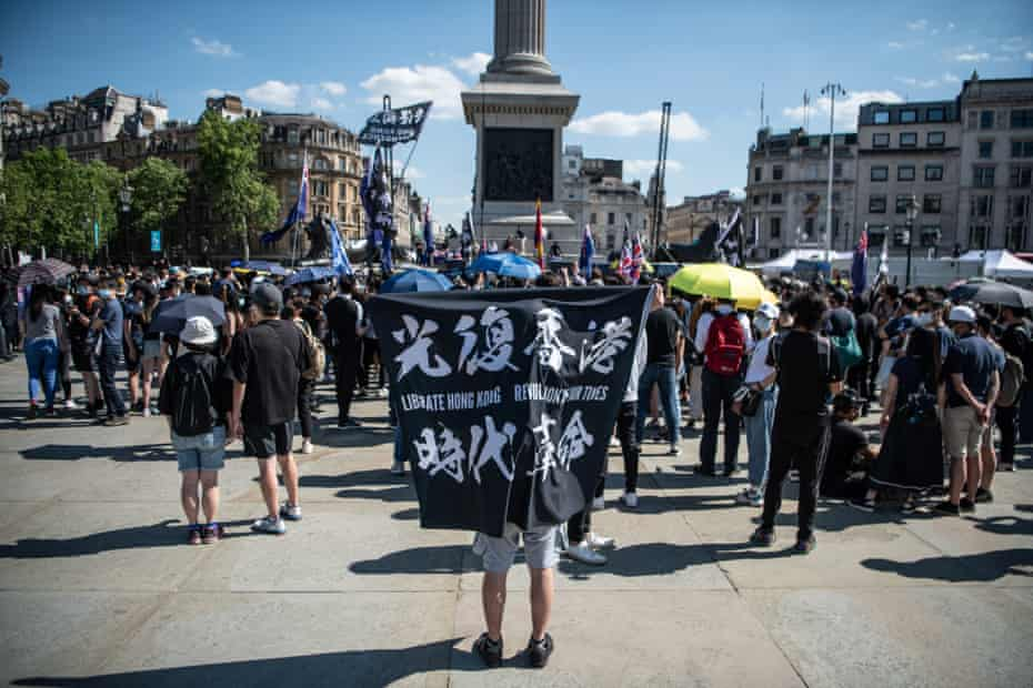 Protesters attend a rally for democracy in Hong Kong in Trafalgar Square in London on 12 June 2021.