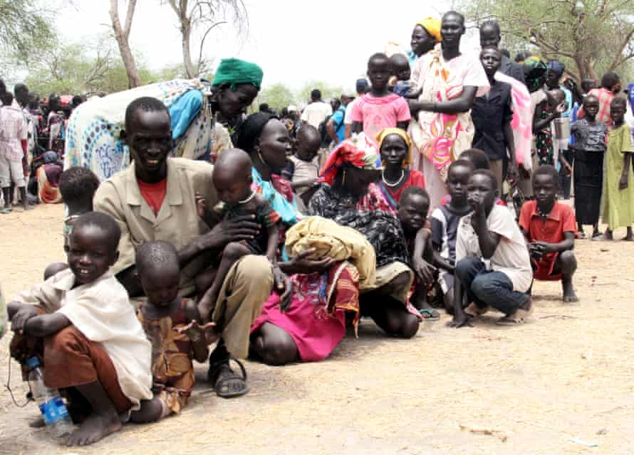 Residents displaced due to fighting between government and rebel forces in Malakal wait at a World Food Programme outpost.