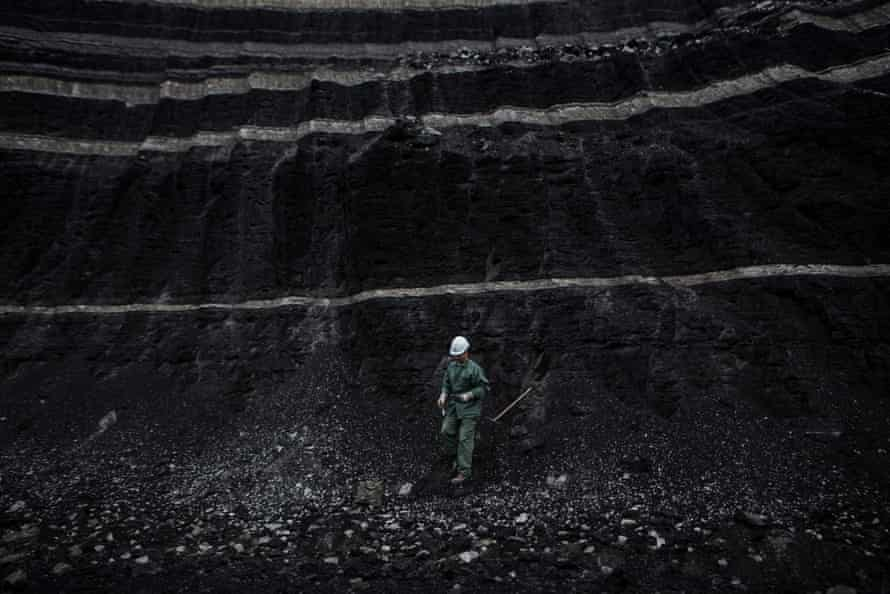 A PPC worker collects a coal sample.