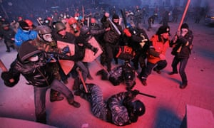 Maidan protestors surround police officers during the uprising that brought down the previous government in Ukraine.