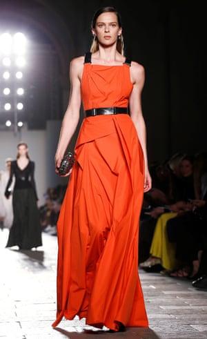A model wears a red full-length dress on the Bottega Veneta catwalk