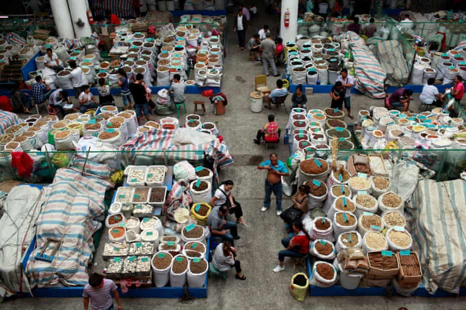 Traders wait for customers at a traditional Chinese medicine market in Bozhou, Anhui province, China.