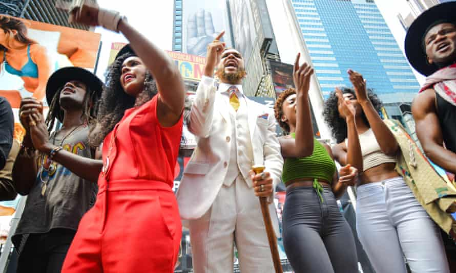 Janelle Monáe (in red) and members of Wondaland chant the names of black Americans killed by US police in the Protest song Hell You Talmbout.