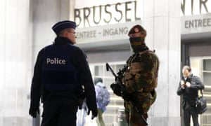 Police officers in front of the central station in Brussels, Belgium